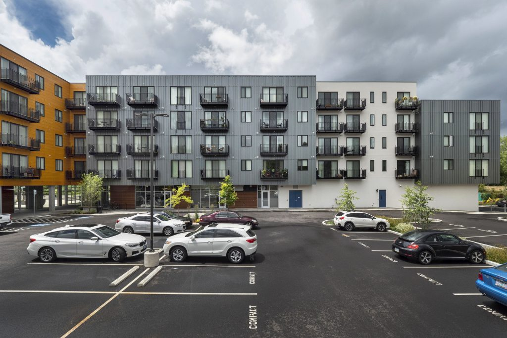 Luxury Apartments in Eugene-Amazon Corner Apartments Parking Lot By Building Exterior With Private Balconies